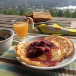 Homemade pancakes and strawberry coulis, freshly squeezed OJ, eggs from hens at the B&B, fresh f