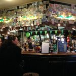 Scores of foreign banknotes above the bar