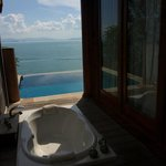 The soaking tub, pool and view over the sea to Phuket