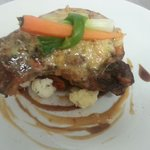 Smoked pork chop with a blue cheese sauce served with seasonal veg and a choice of either hand c