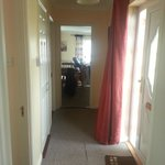 View from bathroom down hall to dining area