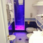 Bathroom with shower which changes colour