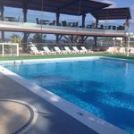 Swimming pool and hotel bar area.