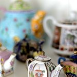 An elegant collection of mini teapots