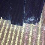 Carpet shreds, grunge at door frame.