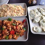 Mixed friend rice, kungpao chicken and dumpling with soy sauce