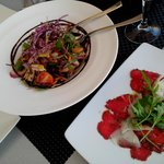 Raw beef and rustic salad
