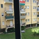 view from hotel to residential blocks of drying the laundry in the windows. Loudly in the backya