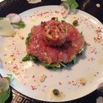veal carpaccio & tartare served on top of a spring salad