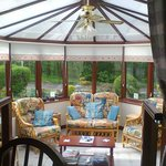 The Conservatory looking towards the Road from the Breakfast Table