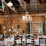 Vintage canoes and a chandelier in the rafters of the main barn