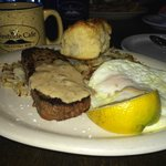 My bison meatloaf with eggs over easy and hash browns plus biscuit.