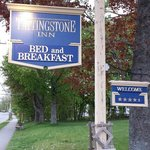 The inn's sign from the driveway entrance.