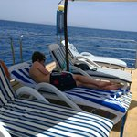 sun deck, sitting on the ocean