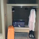 suitcase stand and clothes hanging area