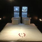 The bed, with rose petals