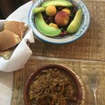 Chicken Tajine with raisins and fruit bowl