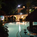 View of the pool and restaurant at night