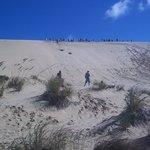 Sand surfing