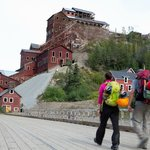 Walk through historic Kennecott on your way to the Root Glacier