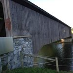 Covered bridge, locals not happy you are there..  They don't want you to stop. Look closely