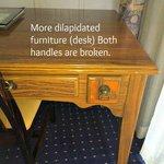Broken handles on desk
