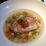 Pan roasted Yellow-Fin Tuna over corn and smoked bacon chowder and topped with red pepper relish