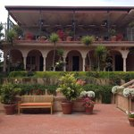 The beautiful terrace upstairs is where breakfast is served, you can sit inside or outside. It w