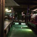 Water surrounds the bar - looks beautiful at night