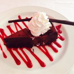 Flour-less chocolate cake with raspberry sauce. AMAZING!