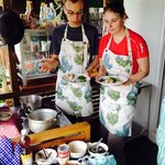 Lovely customers helping each other to create delicious Tom Yum Soup for their Thai cooking less