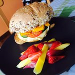 Sandwich with bacon,eggs & cheese served with fresh local fruits