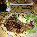 Флорентийский стейк в ресторане при отеле
