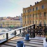 Балкон с видом на город и канал Грибоедова
