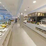 Restaurant buffet at Aparthotel Playa de Muro Suites
