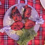 Tandoori chicken nicely wrapped so that we can eat with our hands