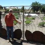 Jim Kyle, creative artist used materials on the property to make this desert fence entrance gard