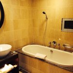 Executive room bathtub with TV, double shower also