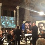Maestro Andrea Colombini directing the Lucca Philharmonic Orchestra