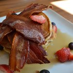 Pancake with seasonal berries, crispy bacon and maple syrup