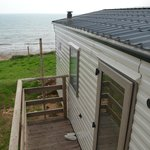 View of cliff side static caravan with beach