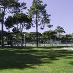 Tennis courts, kids play area and bar