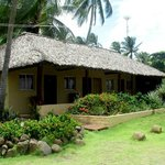 Palm thatched roof and cool corridor