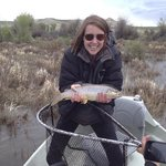 Carolyn and her first brown trout.