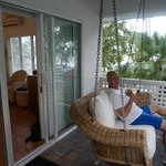 Swinging chair outside room overlooking the beach