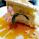 """Soon to be Famous"" coconut cake with passion fruit sauce."