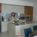 1702 Guest enjoying the kitchen + wine