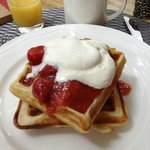 delicious waffle with rhubarb comport