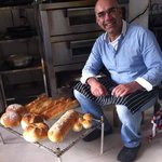 Nuhi behind some of the breads he baked for a friend's restaurant in Dali.