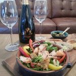 Delicious ginger, chilli & lime infused Hot Salmon Salad served with homemade olive and tomato b